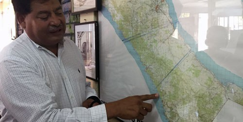Octavio Ortega points at proposed canal routes on a map of Nicaragua in his FUNDEMUR office building on March 9, 2015, in Rivas, Nicaragua. (Photo by Dominic Valente)