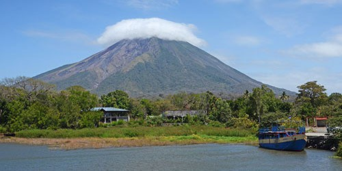 Clouds swirl over the Concepcion Volcano, the largest of the two volcanos that make up the island of Ometepe in Lake Cocibolca. Below is the town of San Jose, one of the two port cities on the island. (Photo by Cydney McFarland)
