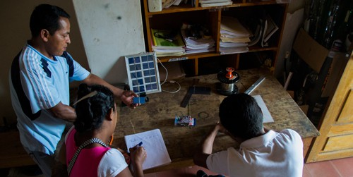 Jorge David López teaches two Grupo Fénix interns, Melvin Antonio Gonzalez and Erlinda deJesus Arroliga, how to build small solar panels on March 10, 2015 for a group of students that will be visiting Sabana Grande, Nicaragua. Grupo Fénix trains international students and interns from the community to build and install solar panels on homes in the area that do not have electricity.(Photo by Danika Worthingon)