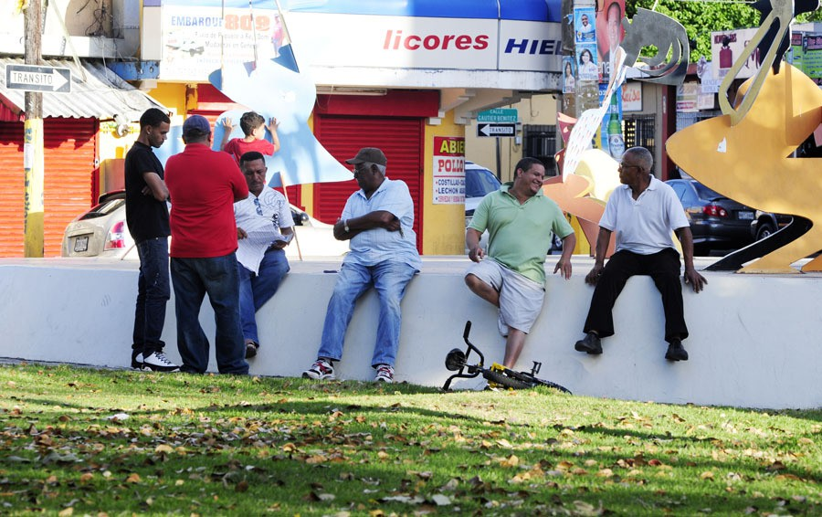 ... Community members gather within the Plaza Barcelo of Barrio Obrero in Santurce, Puerto Rico.