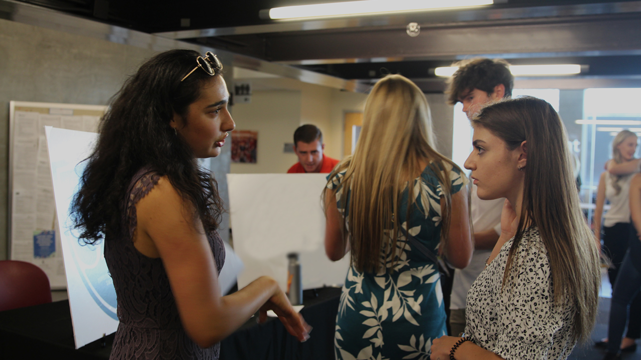 Cronkite students discuss school projects.