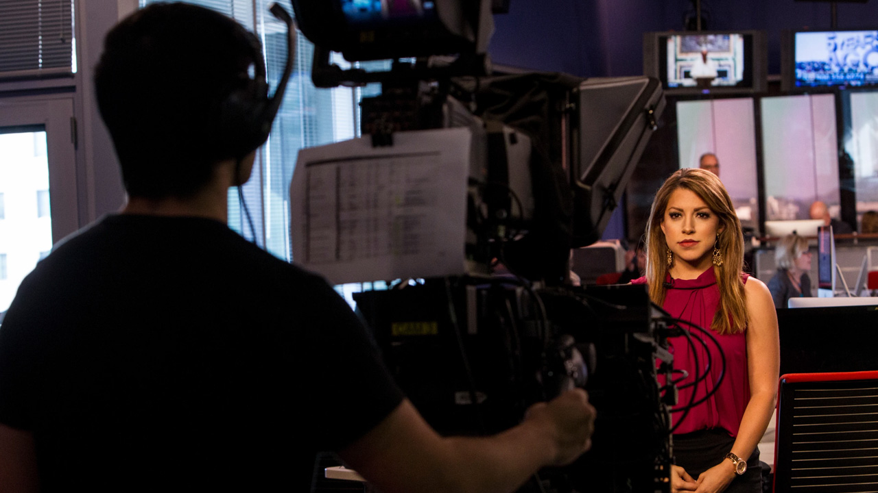 A Cronkite student delivers the news in front of a camera.