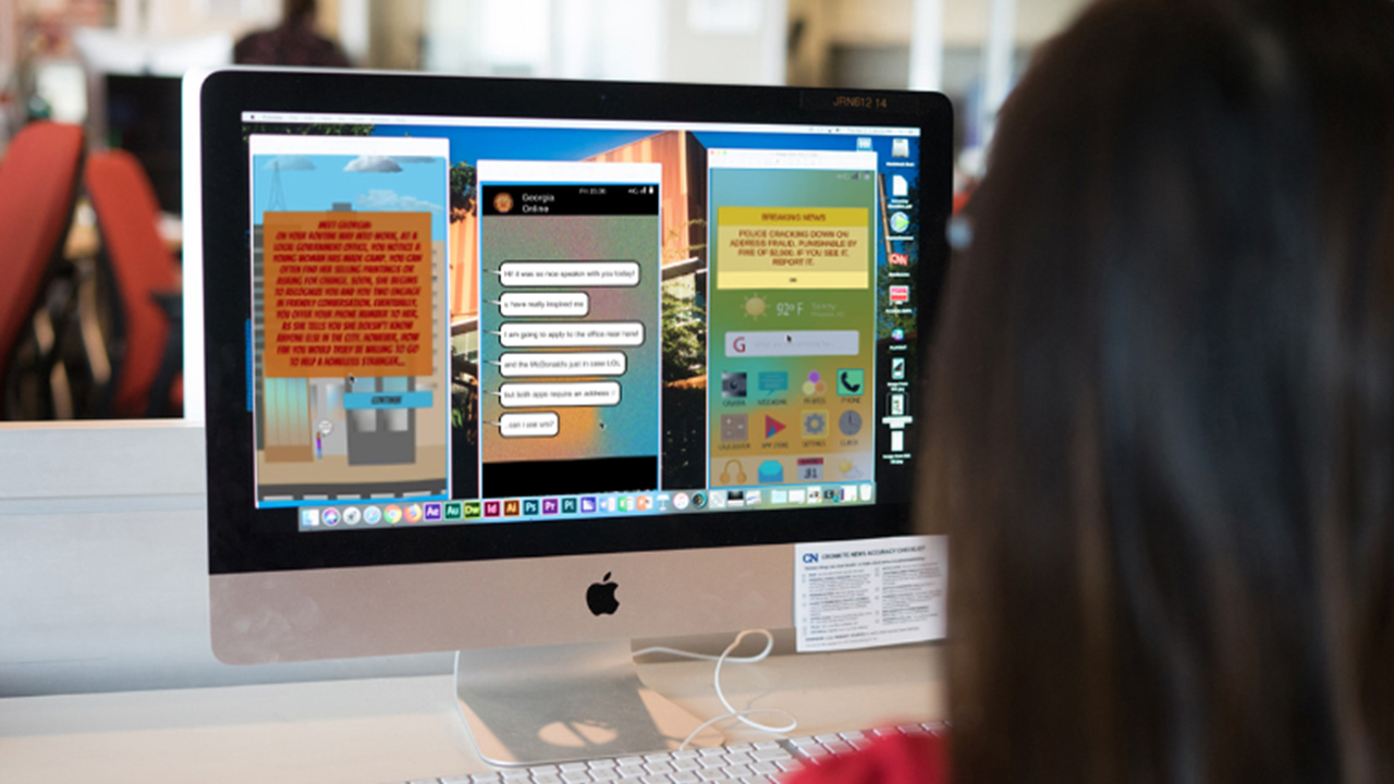 A student builds a game on a computer.