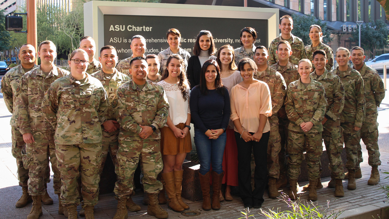 The PR Lab students take a picture with military members.