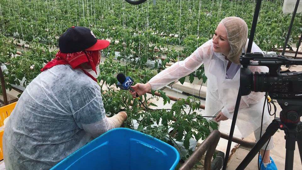 Journalism student interviews a farmer.