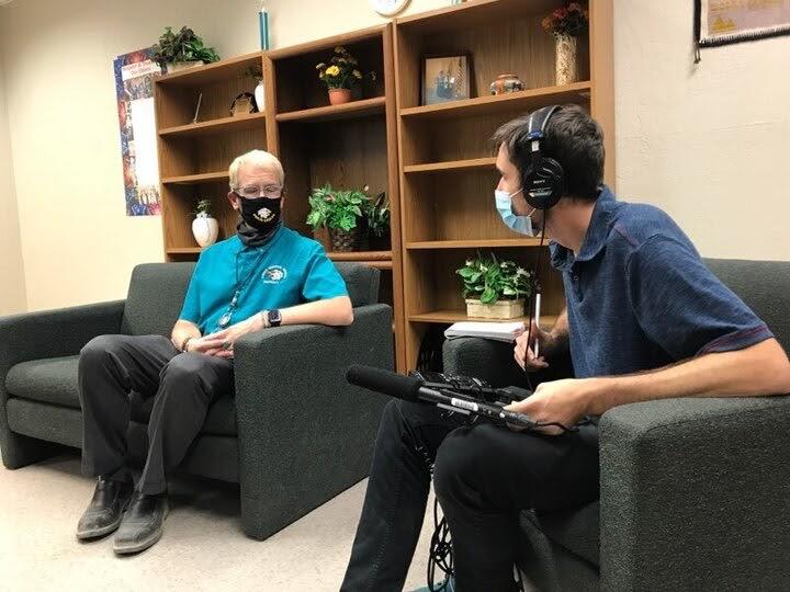 A Cronkite student interviews a man.