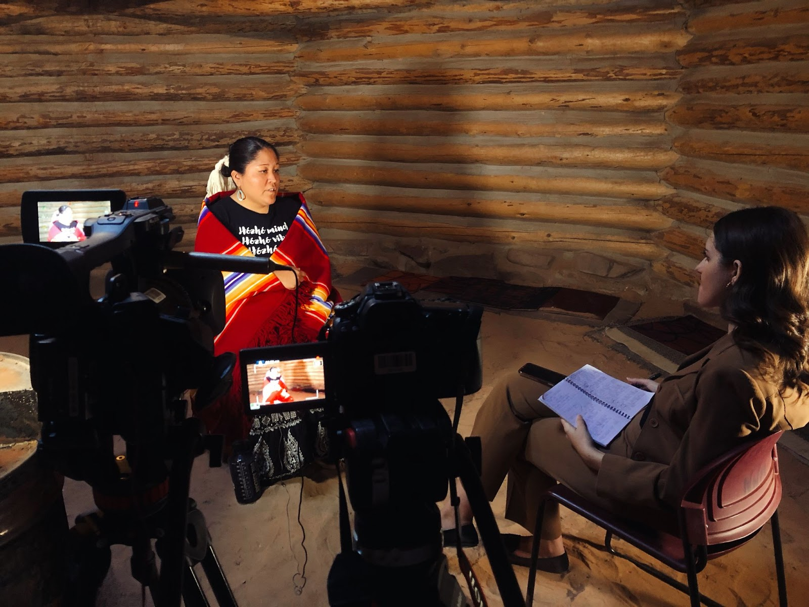 Cronkite students interview a Native American woman.