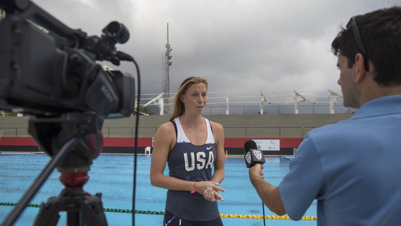 A student reporter interviews an Olympic swimmer.