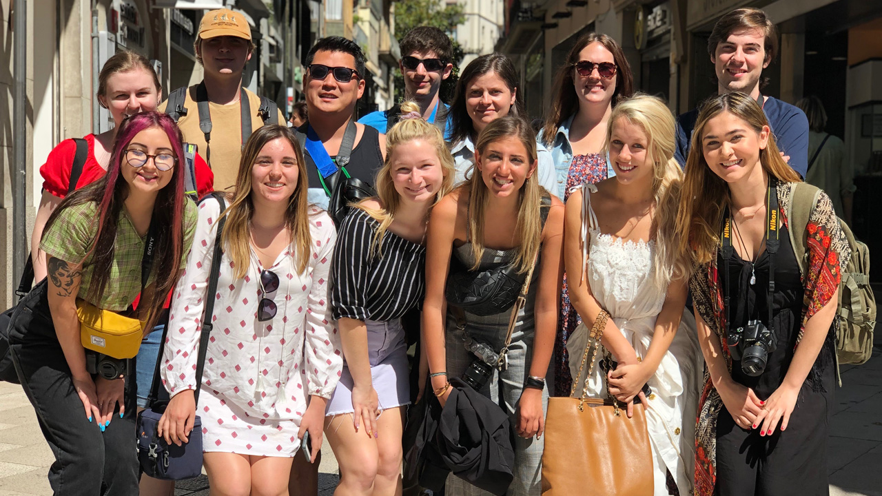 A group of students pose for a photo during a study abroad trip.