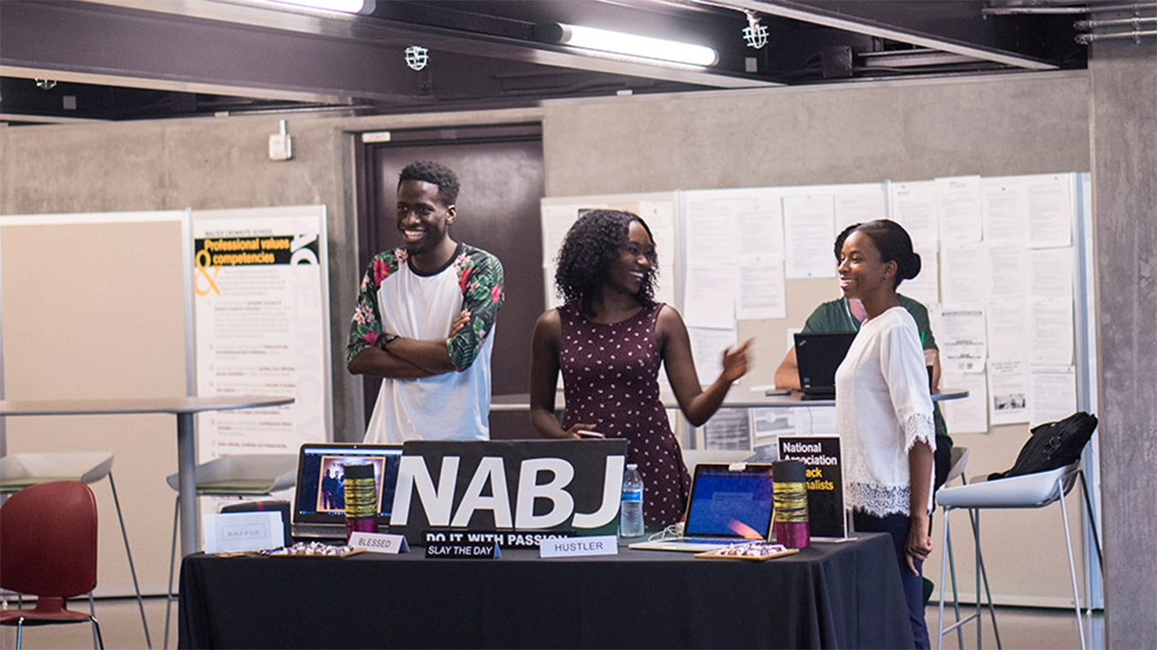 Students tabling for the NABJ at an organizations event.