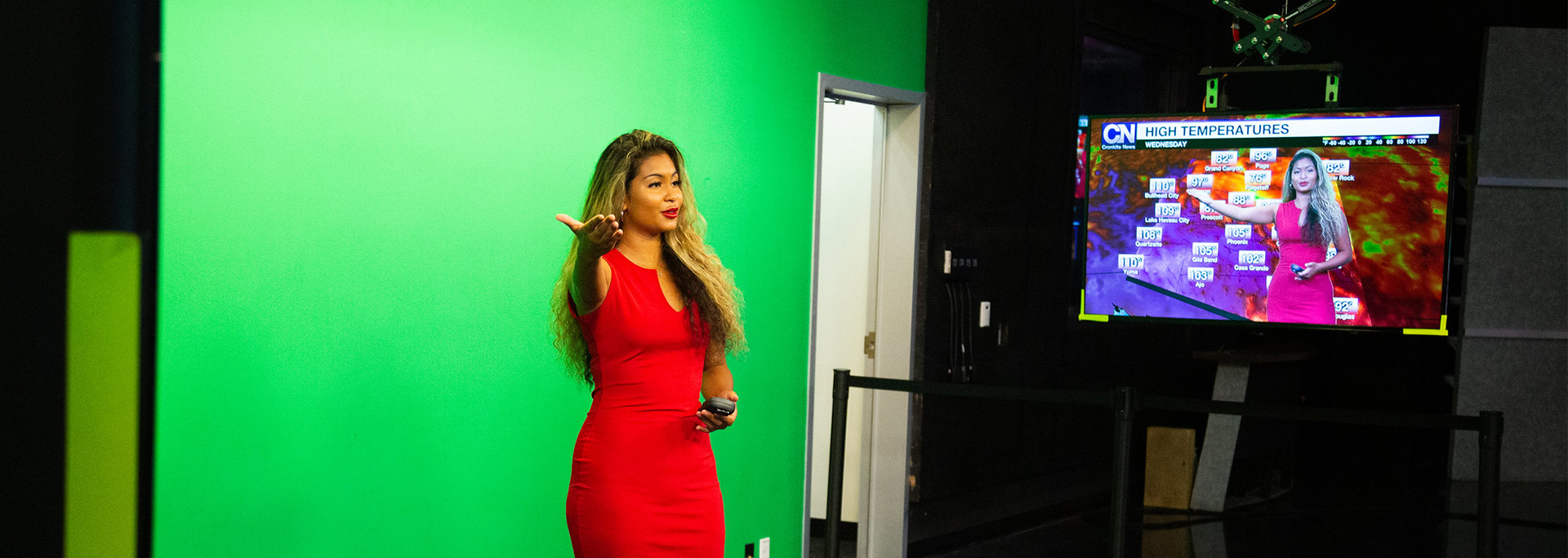 A Cronkite News reporter delivers the weather in front of a green screen