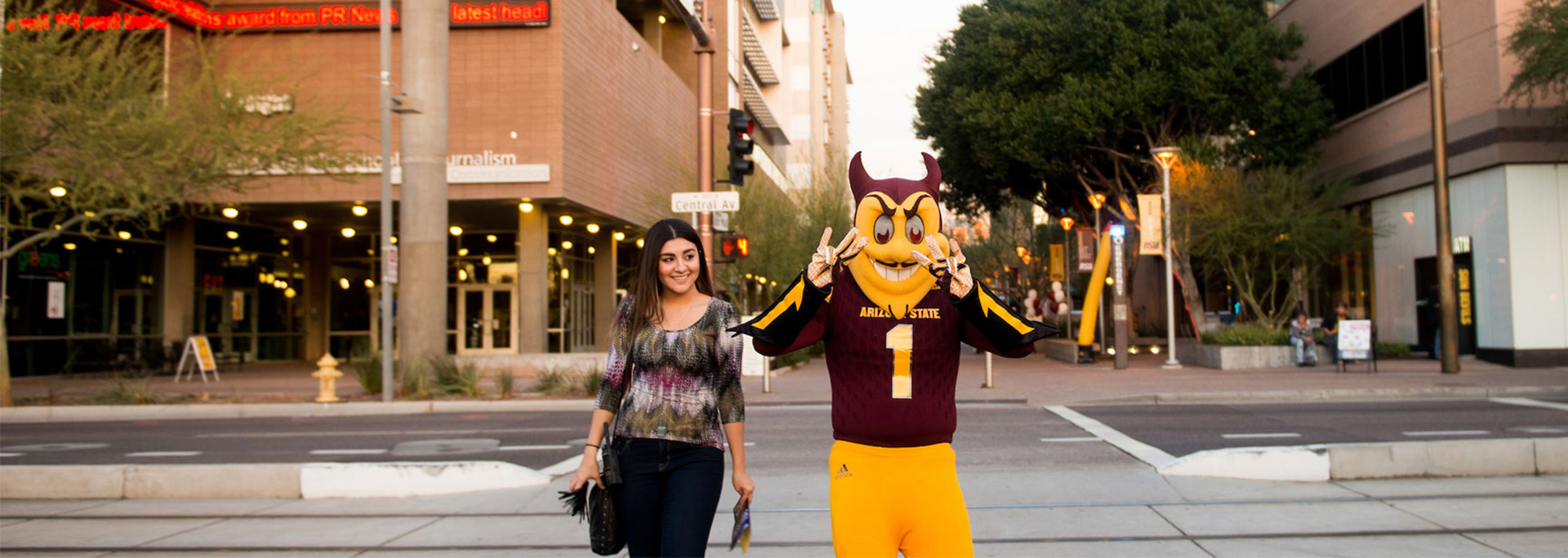 A student walk with Sparky in downtown Phoenix.