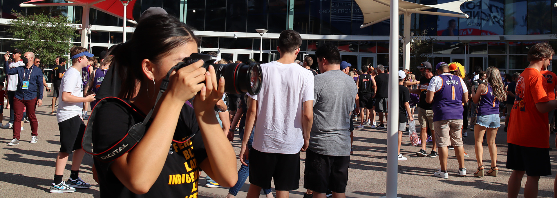 A student photographer takes photos at the NBA FInals.