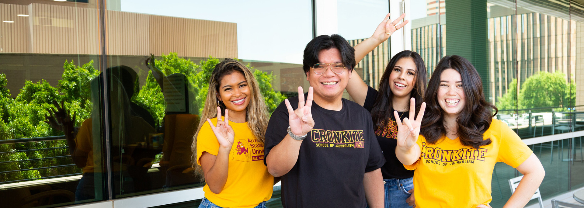 Cronkite students hold up the pitchfork.