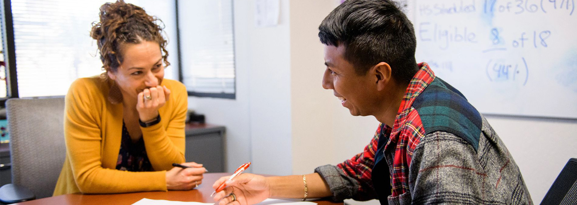 An adviser meets with a student.