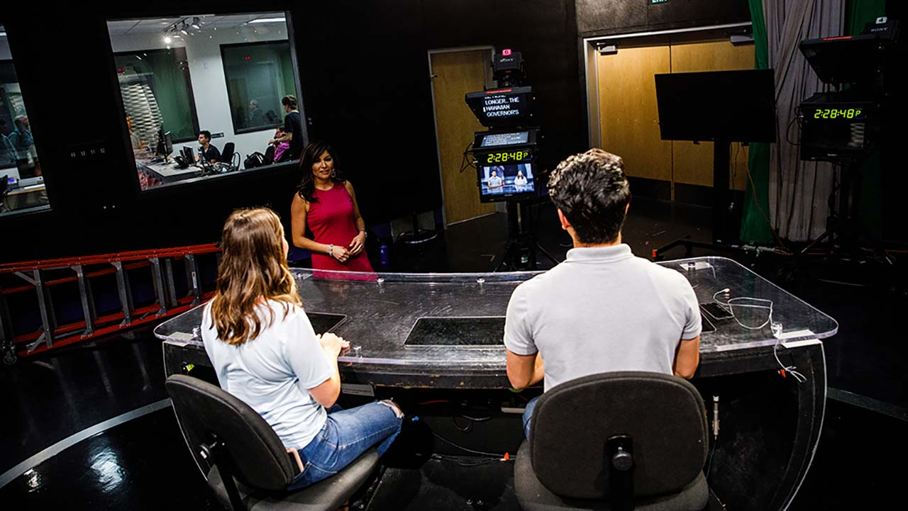 Cronkite students report news from the studio.