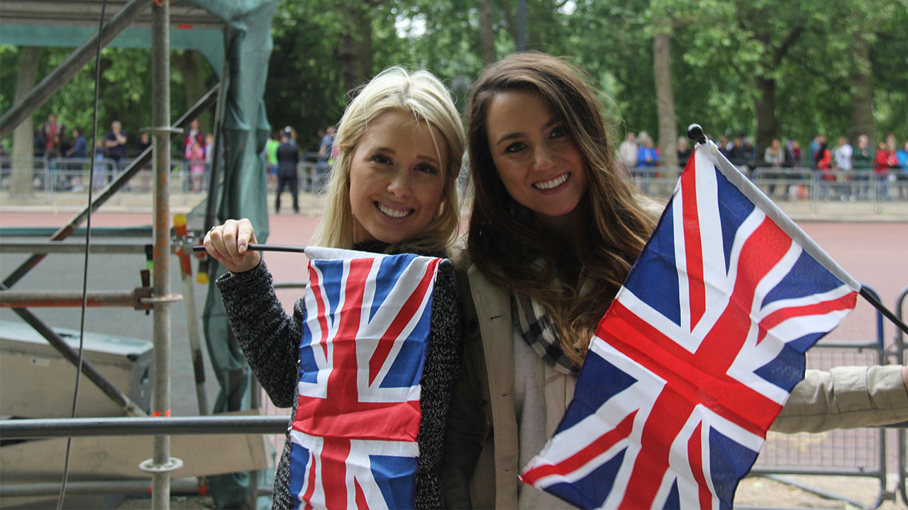 Two Cronkite students hold British flags in London.