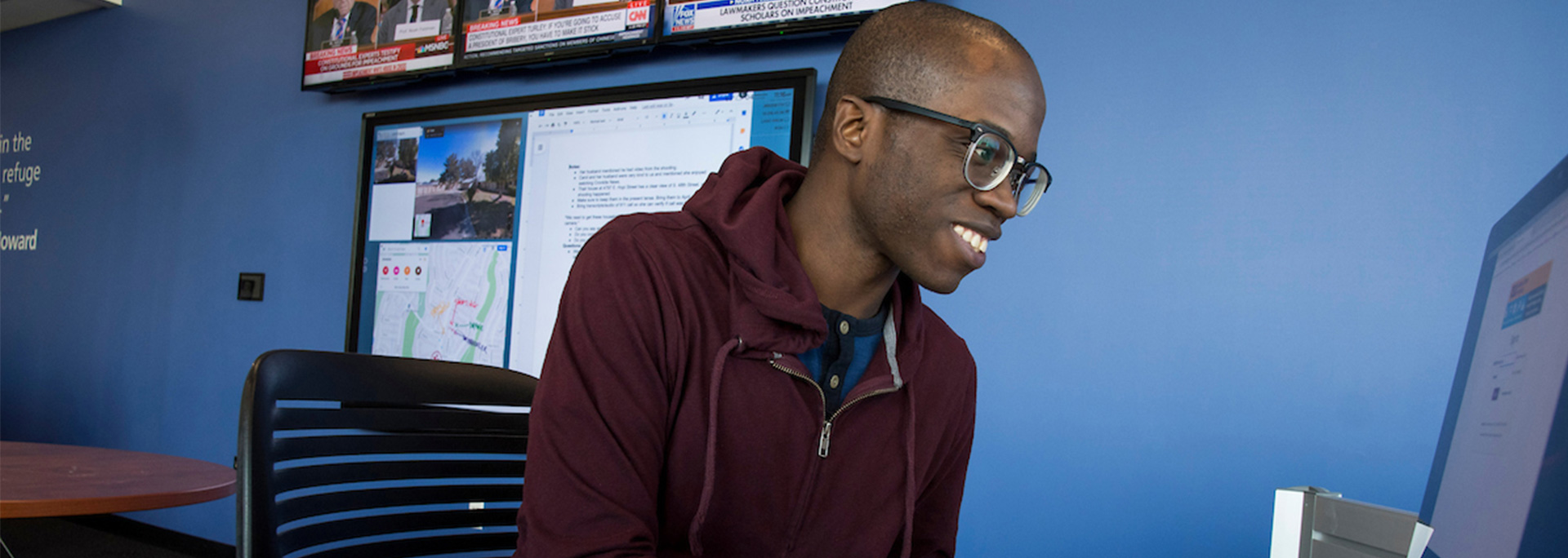 A Howard Center student works on his computer.