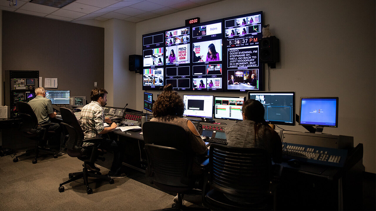 PBS producers work in the studio control room.