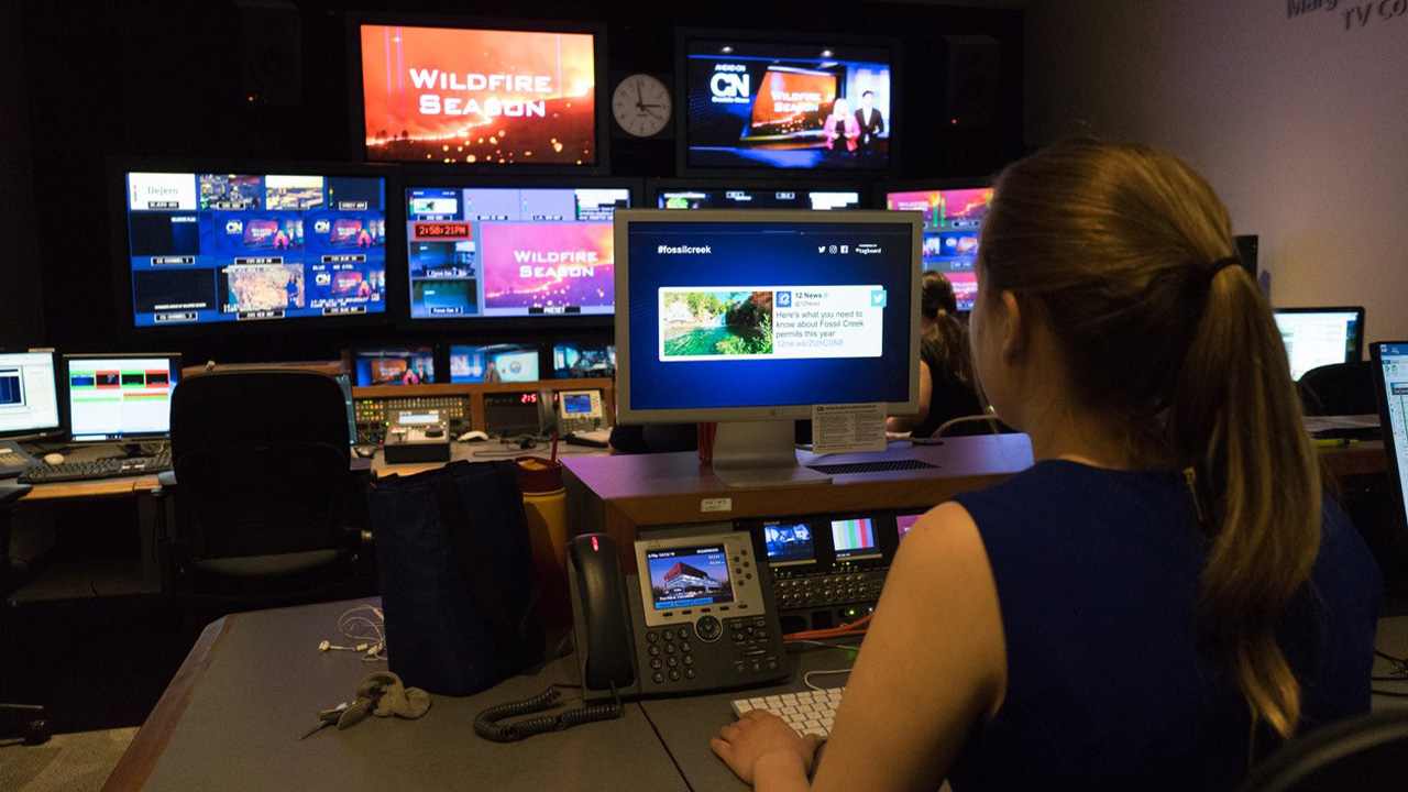 A student sits in the production room.