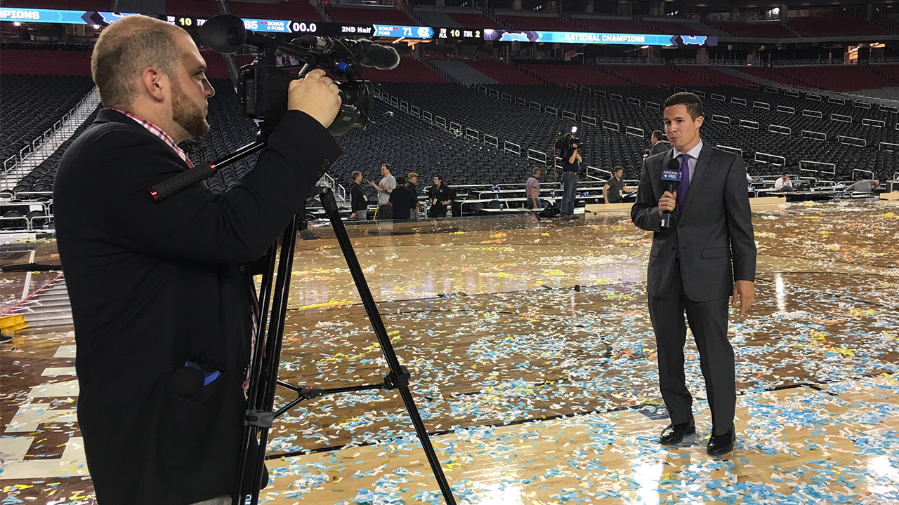 A student reports from a confetti-filled stadium at the Final Four.