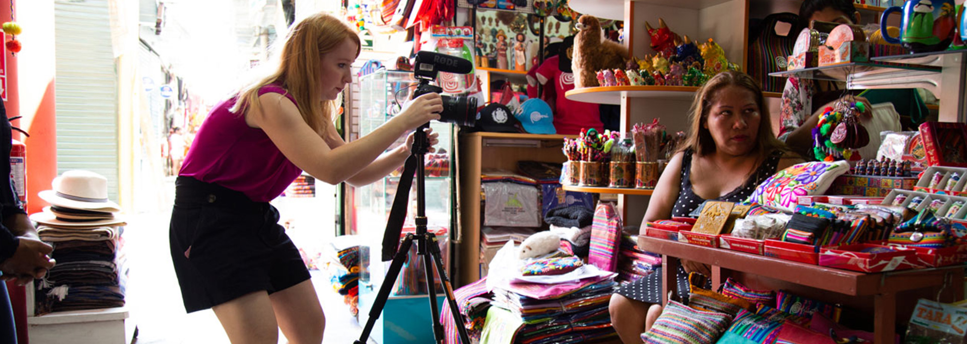 A student films at a local store.